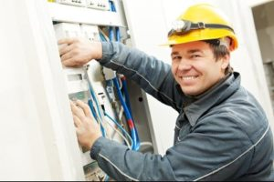 Electrician conducting an energy audit